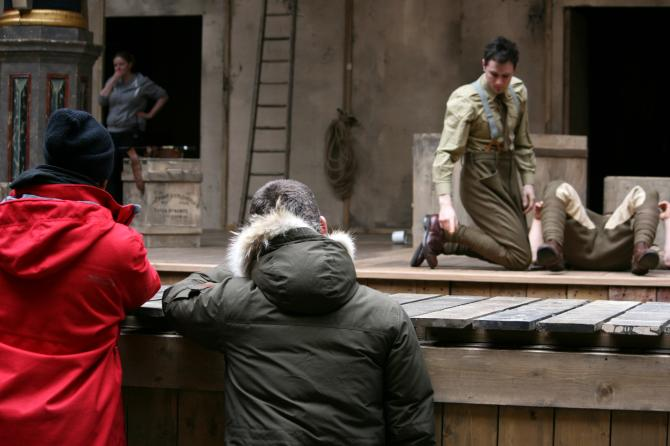 The cast rehearsing a fight during Tech.